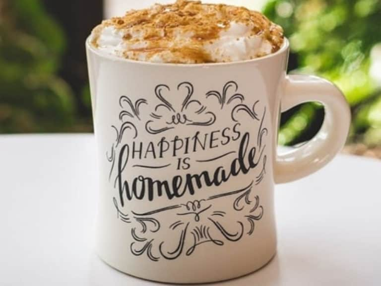Daily Grind Cafe Coffee in a mug that says happiness is homemade